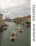 Small photo of View from Academia bridge on Grand Canal and Basilica Santa Maria della Salute and water taxi, Venice, Italy