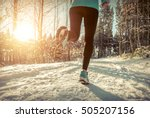 woman running at snowly winter... | Shutterstock . vector #505207156