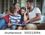 smiling family sitting on sofa... | Shutterstock . vector #505213096