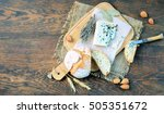 brie cheese on a wooden... | Shutterstock . vector #505351672