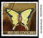 Small photo of COMOROS - CIRCA 1970s: A stamp printed in Comoros shows butterfly Flying Handkerchief, African Swallowtail or Mocker Swallowtail - Papilio dardanus, brown, circa 1970s