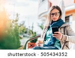 woman typing on the smart phone ... | Shutterstock . vector #505434352