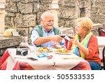 senior couple having fun eating ...   Shutterstock . vector #505533535