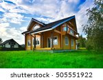 wooden house on green grass... | Shutterstock . vector #505551922