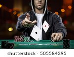 Poker Player Showing A Pair Of...