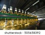 beer bottles on the conveyor in ... | Shutterstock . vector #505658392