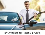 businessman leaning on the car... | Shutterstock . vector #505717396