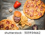 Pizza And Hamburger On Wooden...