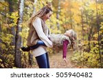 a young mother playing with her ... | Shutterstock . vector #505940482