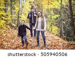a family of four enjoying... | Shutterstock . vector #505940506