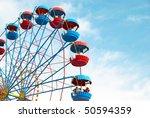 Ferris Wheel On The Blue Sky...