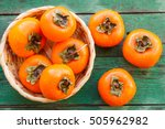 Ripe Persimmons In A Wicker...