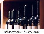 wine bottles in the dark room.... | Shutterstock . vector #505970032