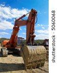 Orange Red Excavator With Empt...