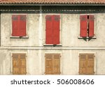 orange and gold shutters on an... | Shutterstock . vector #506008606