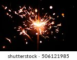 sparklers on a black background.... | Shutterstock . vector #506121985