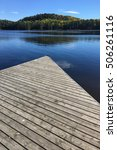 an algonquin dock and lake in... | Shutterstock . vector #506261116