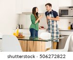 young couple on the kitchen... | Shutterstock . vector #506272822