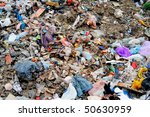 Huge pile of municipal waste on a disposal site - stock photo