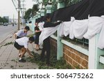 Small photo of BANPROK PATHUMTANI THAILAND OCTOBER 2016 : Unidentified students and teacher bind fabric for embellishment mourning on October 28 2016 in Bangprok Pathumtani Thailand.