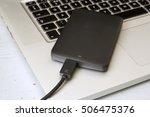 external hard disk over laptop... | Shutterstock . vector #506475376