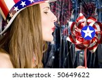 Patriotic Girl with Red, White and Blue Hat and Pinwheel - stock photo