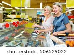 female customers standing near... | Shutterstock . vector #506529022