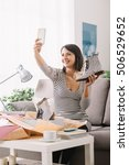 smiling woman unboxing a postal ... | Shutterstock . vector #506529652