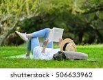 Happy Woman Lying On Green...