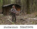 a hunter with a gun near a... | Shutterstock . vector #506655496