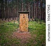 Wooden Outhouse In Forest In...