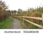Split Rail Fence And Asphalt...