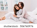 pretty girls in pajamas on bed. ... | Shutterstock . vector #506760976