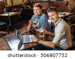 meeting in pub. two businessmen ... | Shutterstock . vector #506807752