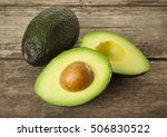 halved avocado and whole fruit... | Shutterstock . vector #506830522
