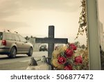 Small photo of View of roadside memorial with cross, candles and flowers. All Souls' Day