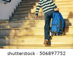 back view of boy walking on...   Shutterstock . vector #506897752