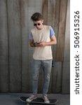 Teenage Skater Boy Using...