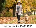 Happy Woman Walking Her Golden...