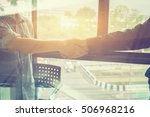 Small photo of Great job,Sealing a good deal,Successful business,Handshake.two businessman shaking hands standing at the working place,selective focus,Vintage tone,copy space