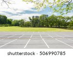 empty parking lot against green ...   Shutterstock . vector #506990785
