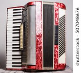 Small photo of Mother of pearl accordion on a gray background.