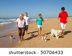 Active Family With Dogs Runnin...