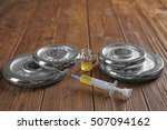 weight disks and syringe on... | Shutterstock . vector #507094162