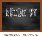Small photo of ABIDE BY hand writing chalk text on black chalkboard
