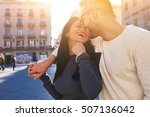 Small photo of Young couple in love having fun while enjoying their spring vacation in Barcelona city. Beautiful wife and husband sped honeymoon in Europe. Attractive female laughing during dating with boyfriend