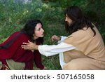 Small photo of Repentant sinner woman touching the robe of Jesus, asking for forgiveness and healing