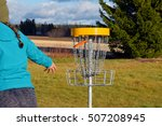 young woman throws disc to... | Shutterstock . vector #507208945