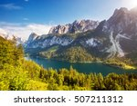 great azure alpine lake... | Shutterstock . vector #507211312