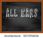 Small photo of ALL EARS hand writing chalk text on black chalkboard